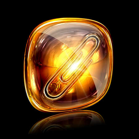 Paperclip icon amber, isolated on black background photo