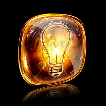 Bulb icon amber, isolated on black background photo