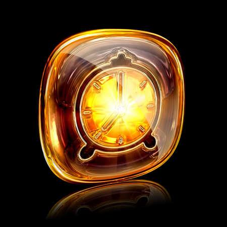 Clock icon amber, isolated on black background photo
