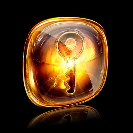 Key icon amber, isolated on black background photo