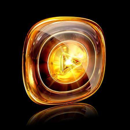 Play icon amber, isolated on black background photo
