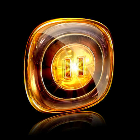 pause icon amber, isolated on black background photo