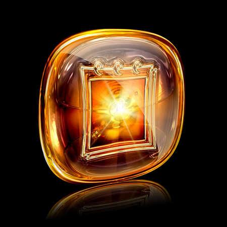 calendar icon amber, isolated on black background photo