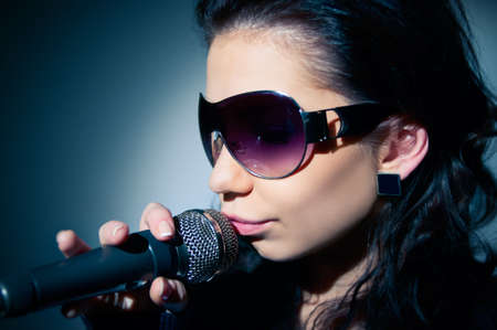Girl Singing  Close-up of a young woman singing on stage photo