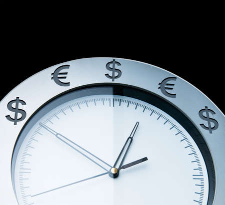 Currency clocks isolated on black photo