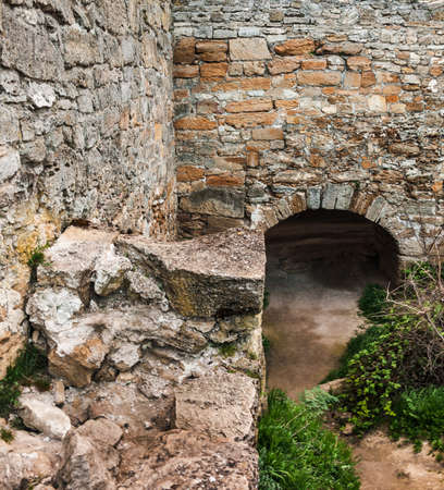 The medieval ruins of the fortress. The passage in the form of a Reklamní fotografie