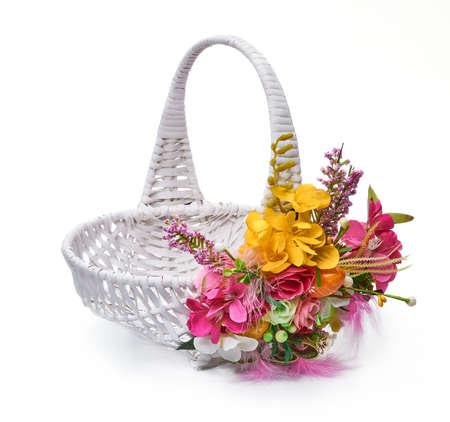 Easter basket from a flower arrangement on white background Imagens