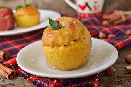 Baked apple with cream cheese, raisins and nuts