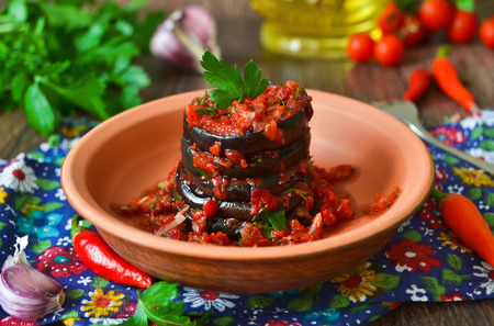 Pickled, spicy eggplant with tomato sauce with pepper