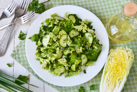 chinese spinach: Salad with Chinese cabbage, cucumber, spinach and herbs Stock Photo