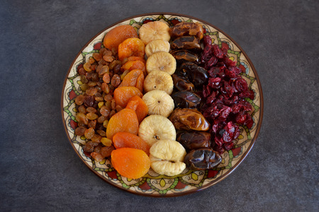 jewish group: Dried fruit in a bowl on a dark background Stock Photo
