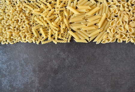 unboiled: raw pasta on a dark background