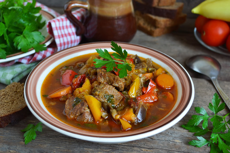 Meat stew with peppers, tomatoes and eggplant Stok Fotoğraf