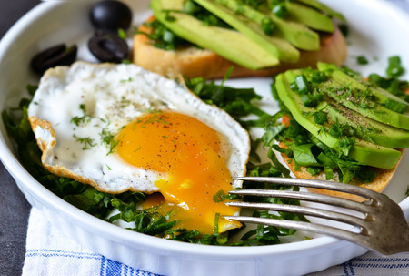 Good morning! Breakfast with toast with avocado, spinach and egg. Stock fotó