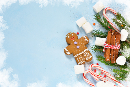 New Years blue background with ginger biscuits, sweets and sweets. Happy New Year and Merry Christmas. Stock Photo