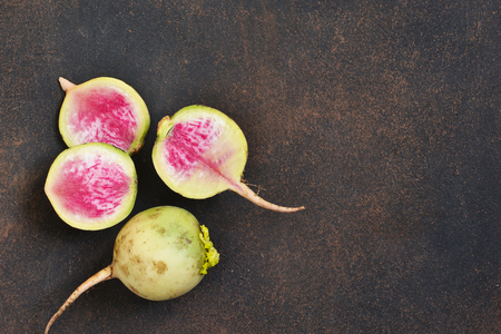 Fresh, young turnip on a concrete brown background. Organic food. 写真素材