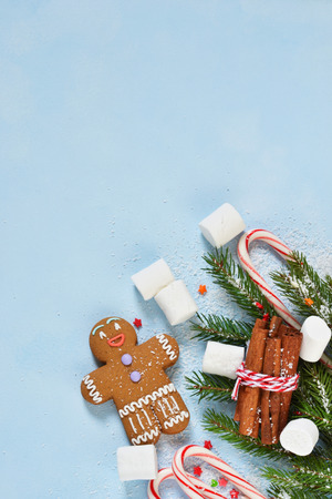 New Year's blue background with ginger biscuits, sweets and sweets. Happy New Year and Merry Christmas.
