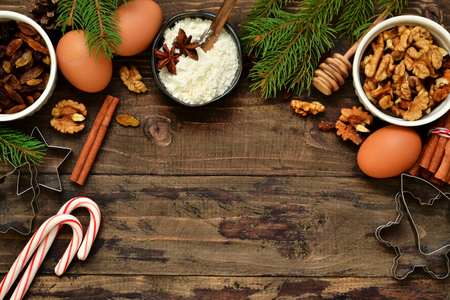 Christmas card with decorations on a wooden background. Christmas baking, cooking process.