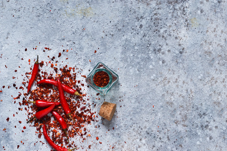 Hot chili peppers on concrete background. Advertising with space for the text. Top view