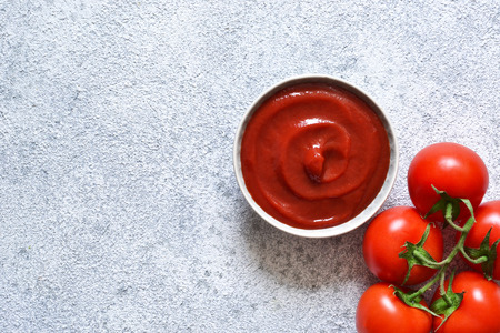 Tomato ketchup sauce with spices and pepper. View from above. 写真素材