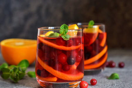 Hot cranberry tea with orange, mint and spices. Stock Photo