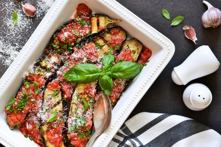 Baked eggplants with toasted sauce, basil and parmesan. Moussaka.