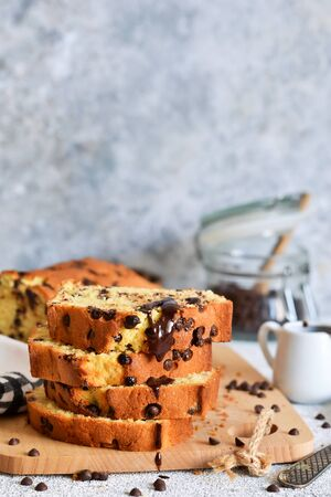 Vanilla bread with chocolate drops on the kitchen table. Slices of cake.