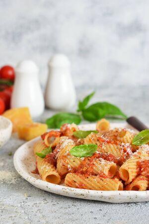 Pasta with tomato sauce and basil. Pasta tartilloni on a dark background. Reklamní fotografie