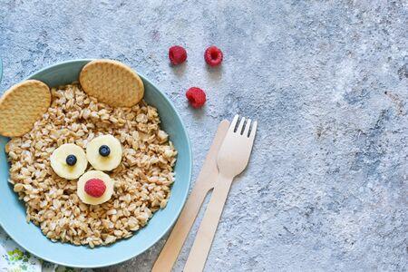 Funny oatmeal for children - bear. Breakfast for children.