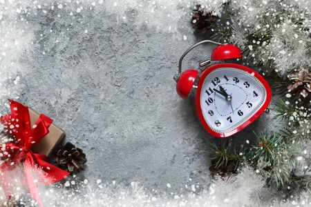 Xmas card. Christmas background with fir and clock. View from above. Stock Photo