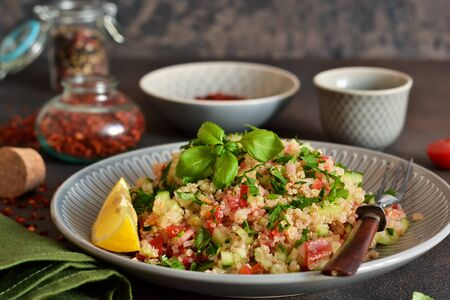 Tabule - a traditional oriental salad with vegetables, parsley and spices.