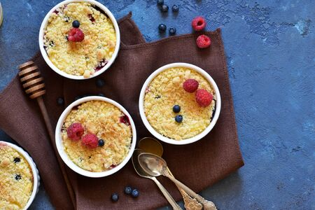 Crumble with berries, honey and almonds. View from above.