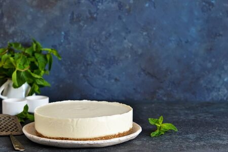 Vanilla cheesecake on a stone background. New York cheesecake.