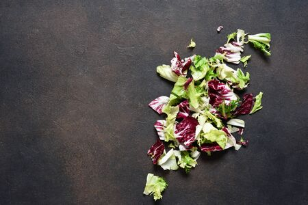 Mix salad, cabbage on a concrete background with place for text. Advertising.