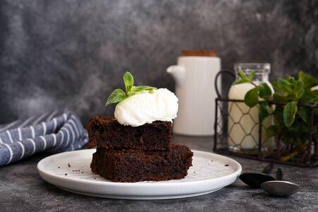 Chocolate brownie with ice cream - a classic American dessert. Stock fotó