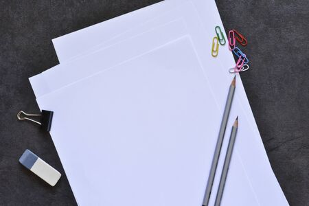 Office set: white sheets of paper, pen, pencil.