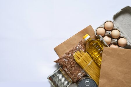 Food donations: butter, eggs, groceries, toilet paper. Food delivery. Groceries on a white background. Stok Fotoğraf