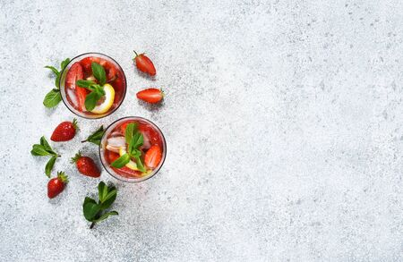 Lemonade with strawberries and mint on a concrete background. View from above. Summer cold drink. Stok Fotoğraf