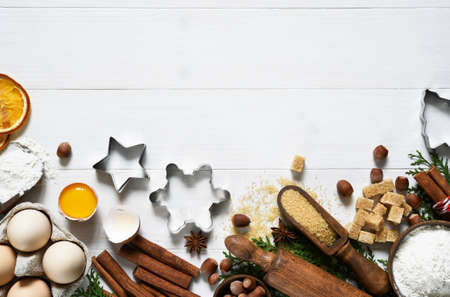 Ingredients for Christmas baking. Food preparation products: eggs, butter, flour, sugar. Food decoration for the new year. Stock Photo