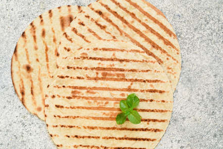 Grilled Mexican tortilla on a concrete background. View from above. Stock Photo