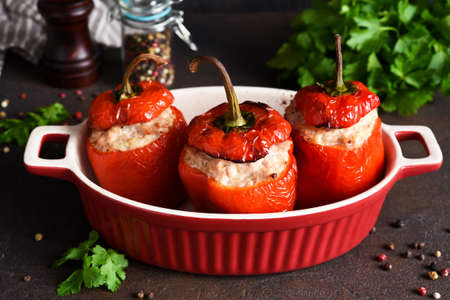 Stuffed peppers baked with meat and rice on a dark concrete background Imagens