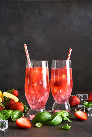 Strawberry juice with mint and lemon. Cold drink with strawberries.