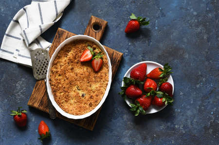 Crumble with strawberries on a benton background. View from above. Stock fotó