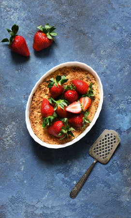 Cheesecake with ricotta and strawberries on a concrete background. View from above. Casserole.