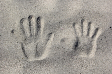 desert footprint: Two tracks from the palms of the hands on the sandy beach