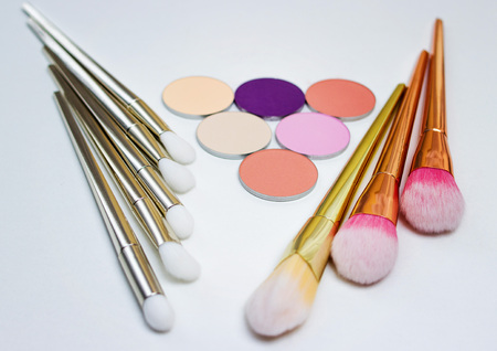 Makeup brushes and  stones, makeup shades. Stock Photo