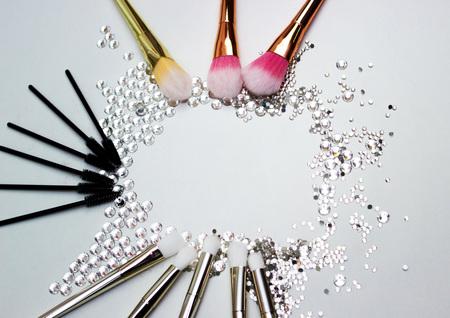Makeup brushes and Swarovski stones, makeup shades.