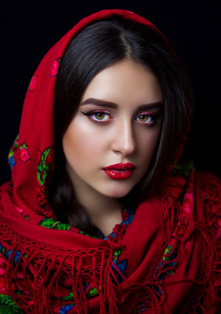 A girl with a red kerchief and a beautiful make-up. Sexy girl.