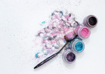 Color pigments for a bright make-up, a brush for make-up.