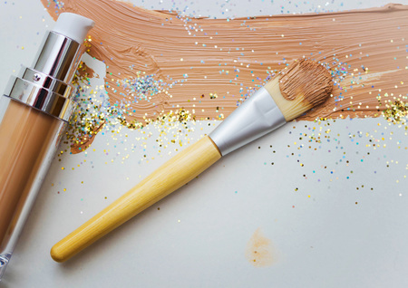 grooming product: Flat brush for makeup, face cream, cream smears Stock Photo